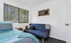 Mahogany Lodge - Byron Bay - master bedroom with couch