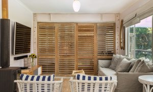Susan's Beach House - lounge and bedroom shutters closed