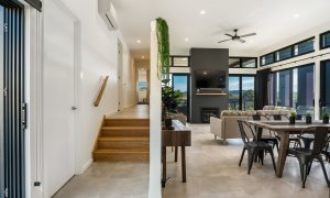 Wollumbin Haus - Byron Bay - open plan living area with stairs to bedrooms