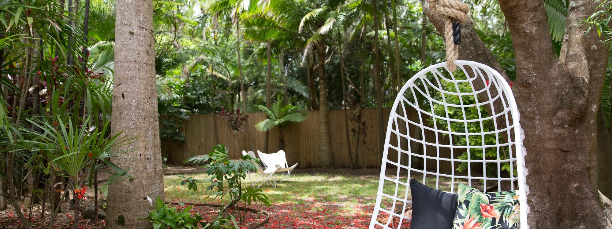 Barrel and Branch - Byron Bay - hanging chair in the gardens
