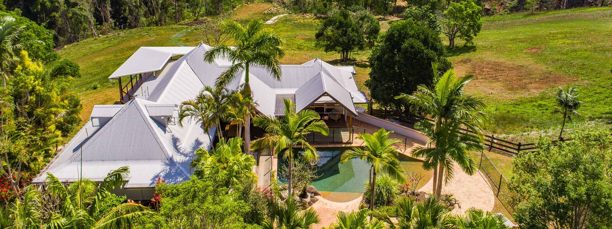 Rockinghorse House - Byron Hinterland - aerial front of house and pool